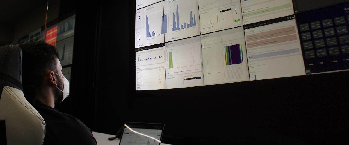 A man in Intellisync control room monitoring the VPN dashboard